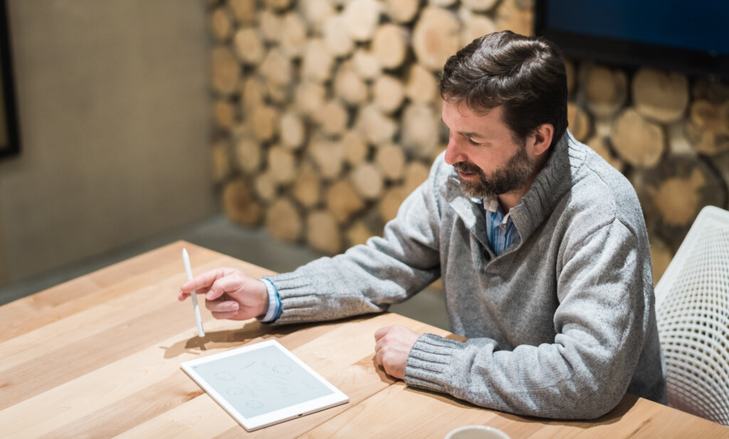 Photo of Owen Matthews brainstorming in the Alacrity Canada boardroom.